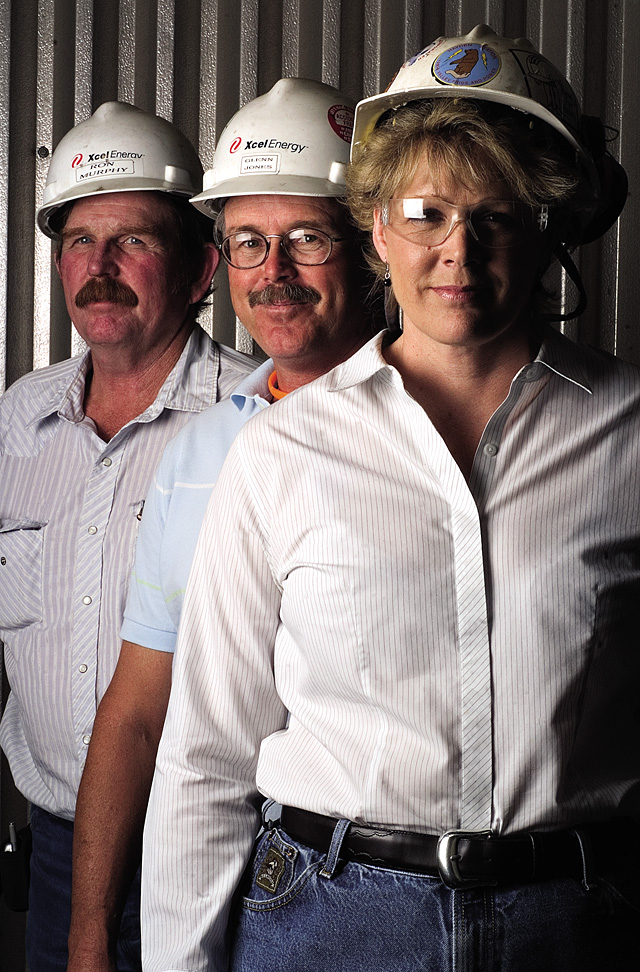 Power plant director Sharon Brady, from front, technical specialist Glenn Jones and Ron Murphy, plant engineer, lead a team of operators at the Xcel Energy-owned Hayden Station in the generation of 446 megawatts of electrical power.