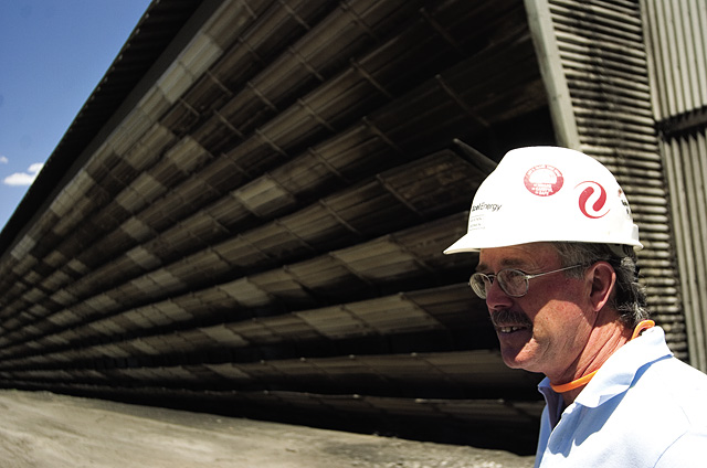 Technical specialist Glenn Jones describes operation of the cooling towers during a plant tour at Hayden Station on July 2. The cooling towers work to cool and condense steam heated during the coal combustion process so that it can be reused.