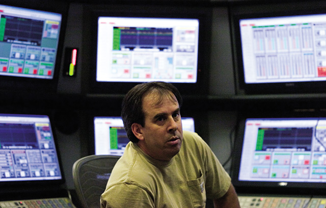 Jeff Scheele, a control room operator at Hayden Station, helps to monitor a series of computer screens July 2. The control room operators are capable of controlling more than 95 percent of all the plant's operations from a single room.