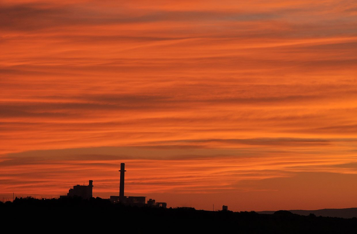 Smoke from area wildfires turned the skies over the Hayden Power Station brilliant colors Friday night.