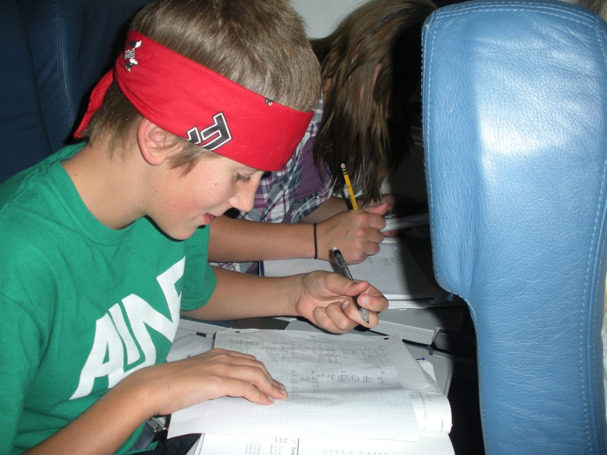 Hunter McLean studies on the plane ride.