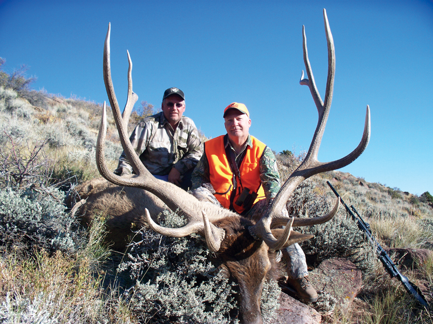Chris Jurney, left, of Craig, and Rick Callison, of Denver, are shown with a bull elk in Unit 201 west of Maybell in Moffat County.