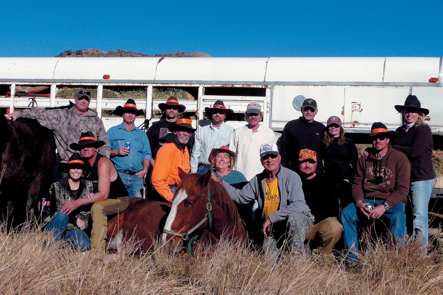The Lawton family, who live in Craig and Grand Junction, and their families pose on Indian Run in Northwest Colorado. The Lawtons have had friends come from Arkansas and Virginia to hunt for more than 20 years.