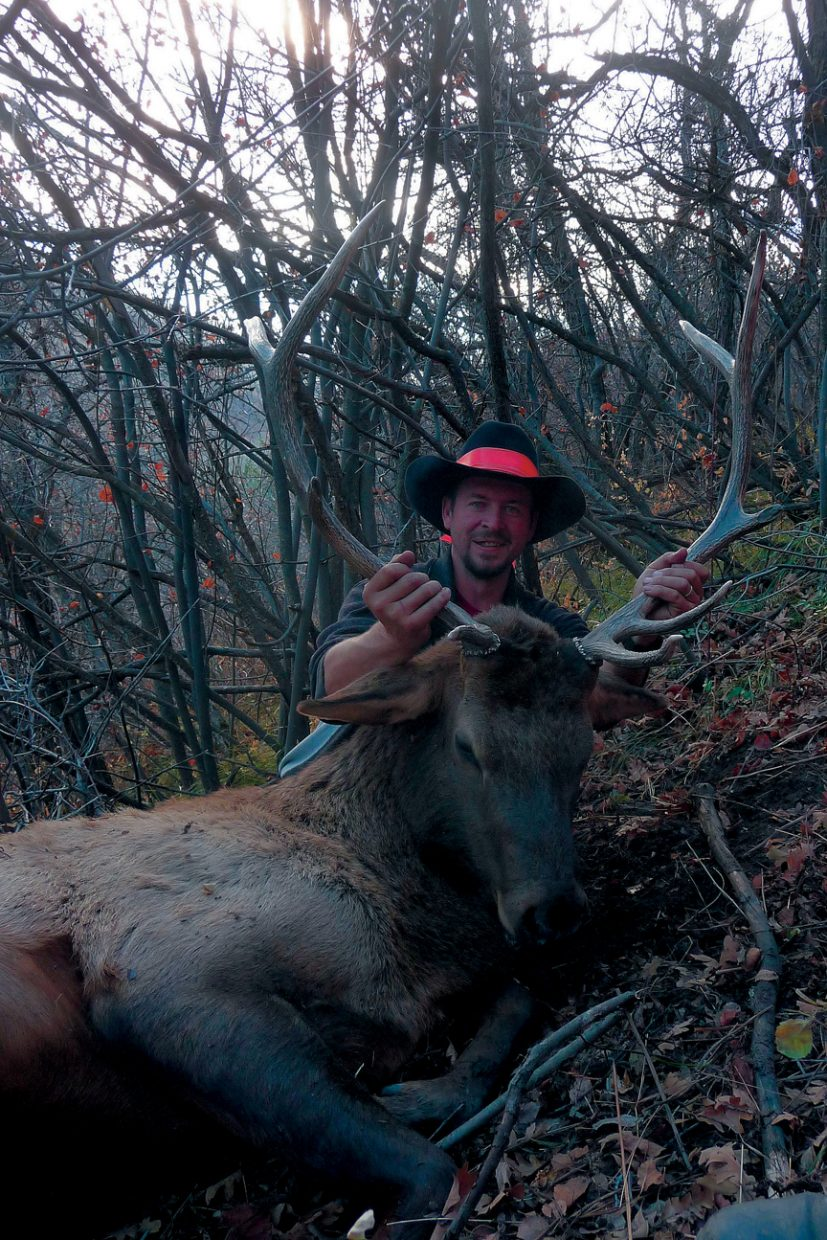 Tony Lawton, of Grand Junction, poses last hunting season with an elk he shot on Indian Run in Northwest Colorado.