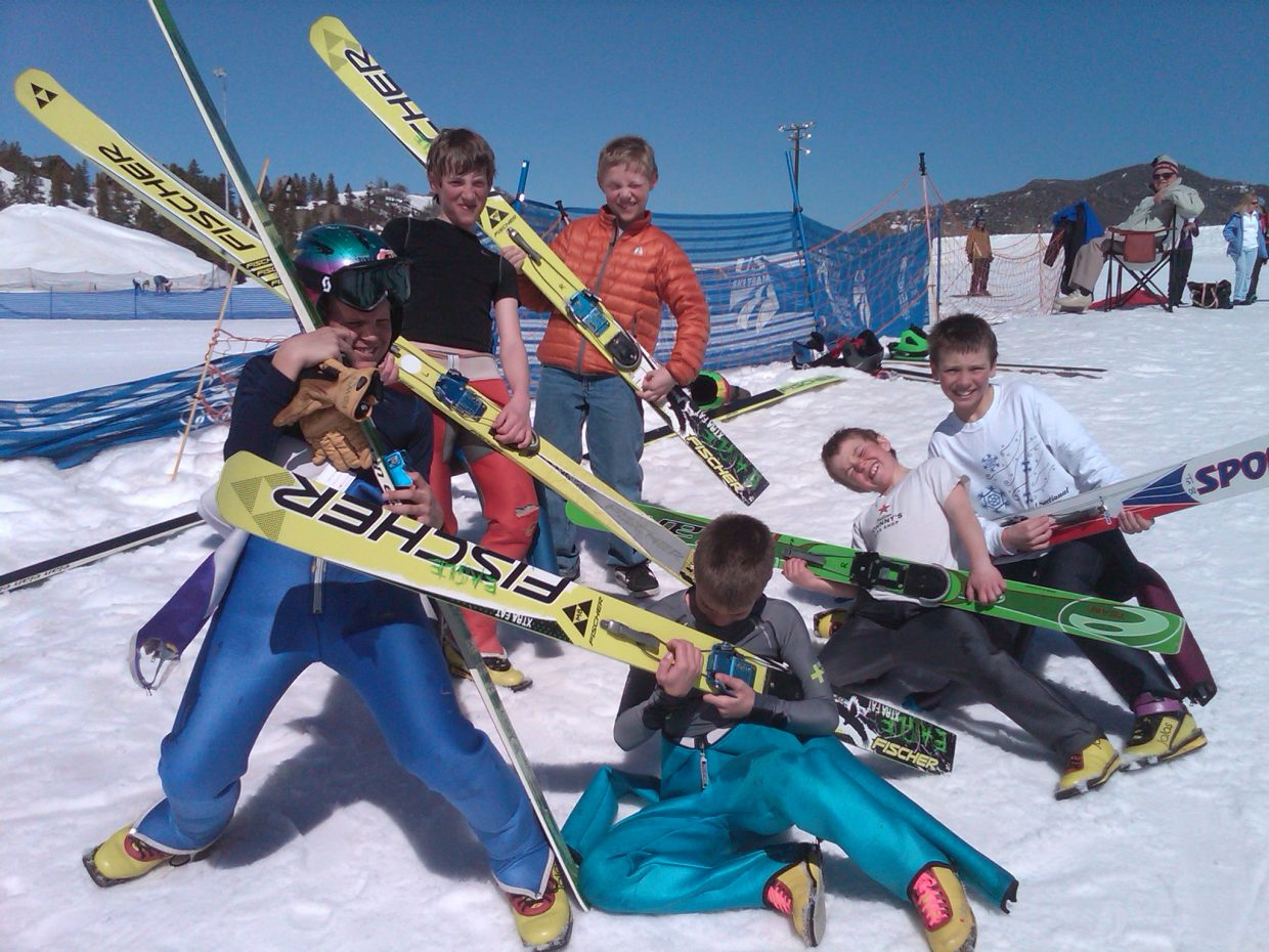These 10- to 11-year-old Nordic combined boys celebrate after their inaugural jump off the HS75 on Sunday.