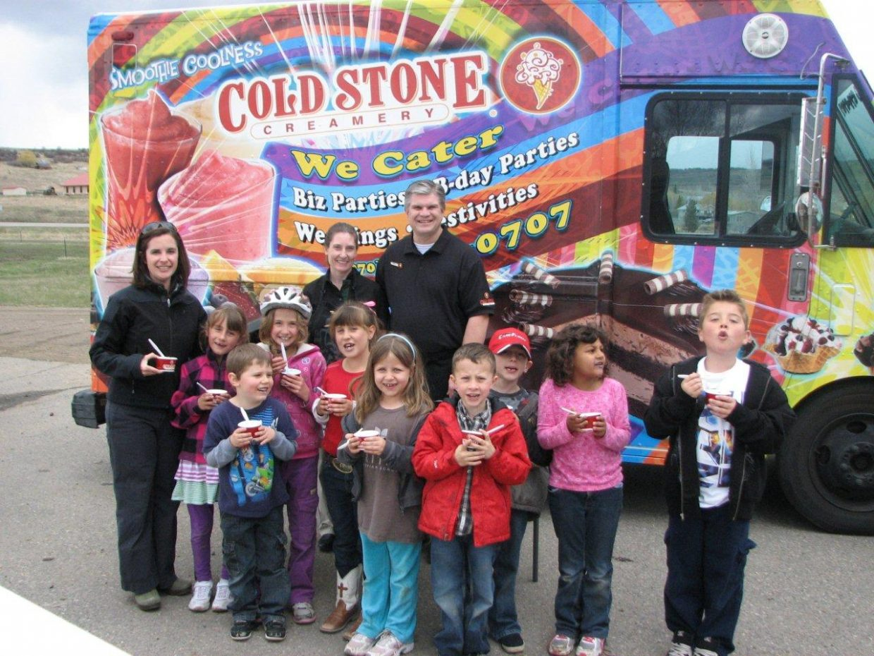 """Heritage Christian School students enjoyed ice cream at Cold Stone Creamery as part of a reading contest called """"March Madness."""" Pictured are, back row, owners Paul and Laurie Van Engelenhoven; front row, teacher Tracie Patterson, Rubi Reagan, Tucker Lewis, Kendall Kelly, Britney Iacovetto, Kileigh Robinson, Jonny Berlet, Caden Krieger, Saunsa Allee and Noah Gagnon."""