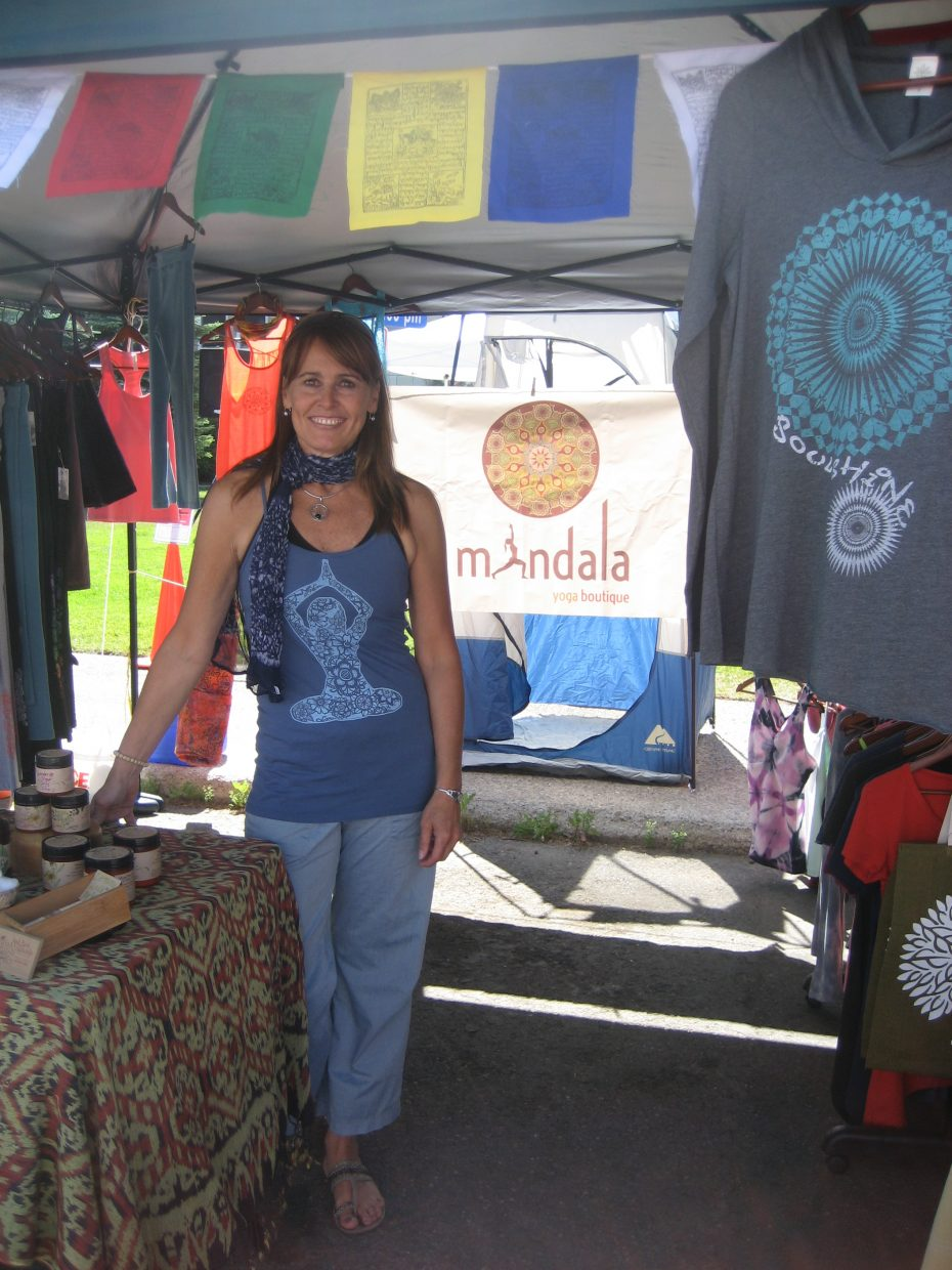 Mandala Yoga Boutique's booth at Saturday's Farmers Market. Shown is owner Cindy Ridley.