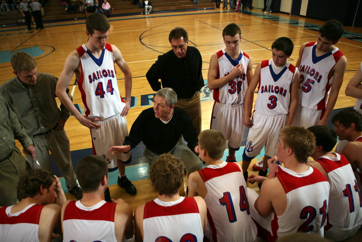 Head coach Kelly Meek gives his Sailors team some instructions during a second-half timeout in the Sweet 16 4A State Basetball game at Widefield High School.