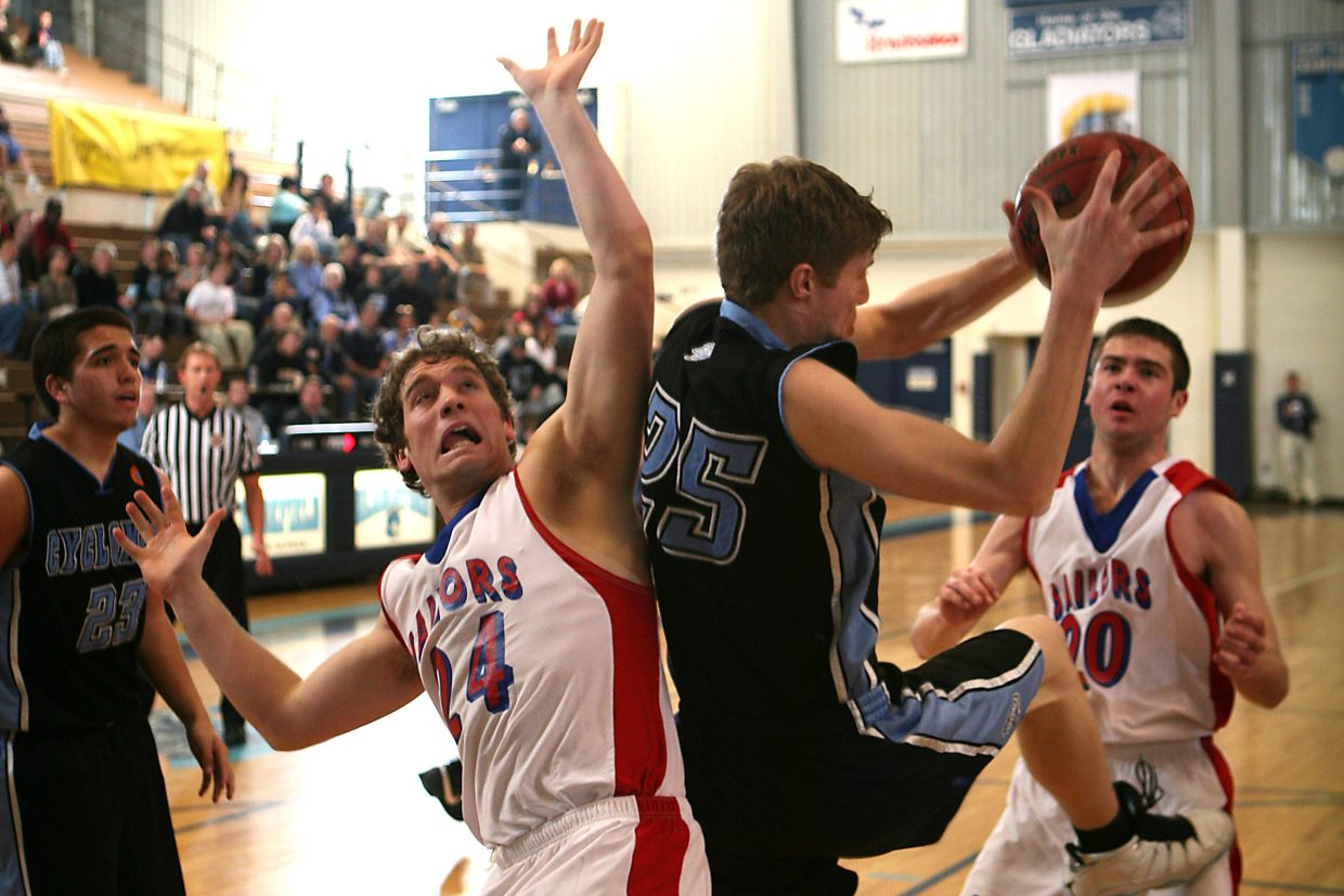Alex Wood, No. 24, battles Kyle Mabry, No. 25, of Pueblo West as Colby Kostur, No. 20, looks to get in the action during second-half play.