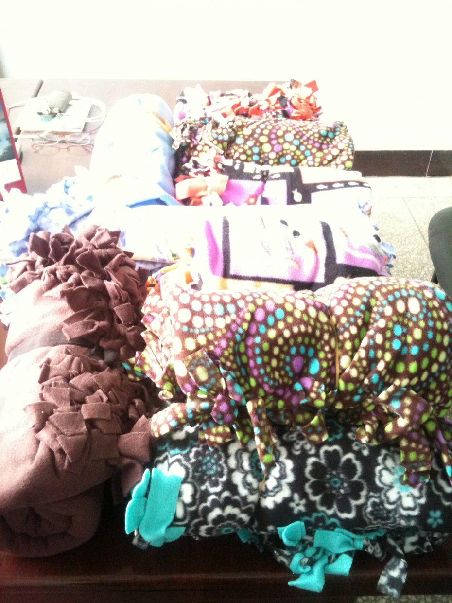 Blankets made and donated by Heritage Christian School students are piled at an orphanage in China. Read more about the students' efforts and watch a video about the project at www.tinyurl.com/coho78q. Submitted by Tracie Patterson.