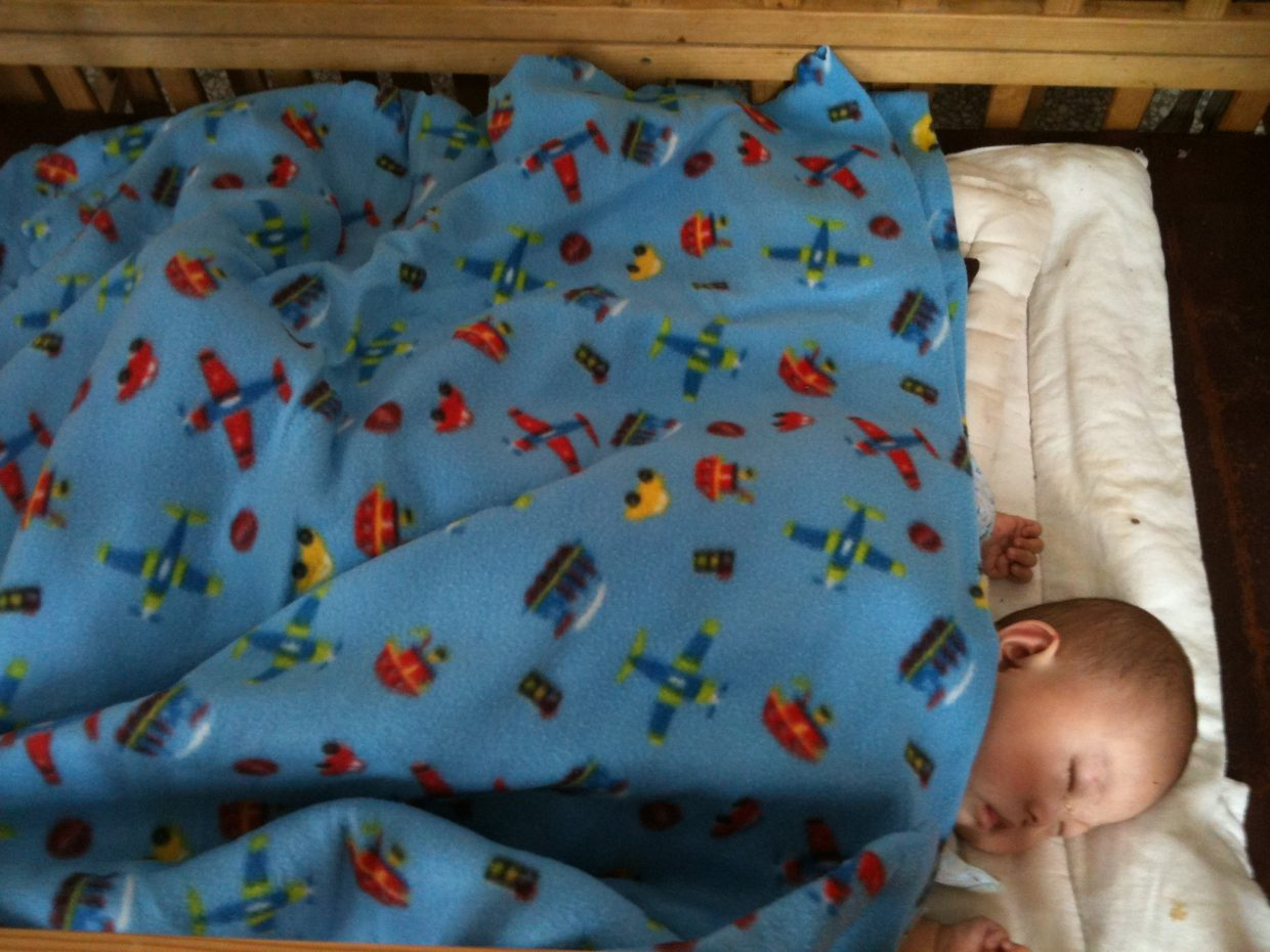 A baby at an orphanage in China sleeps under a blanket made and donated by Heritage Christian School students. Read more about the students' efforts and watch a video about the project at www.tinyurl.com/coho78q. Submitted by Tracie Patterson.