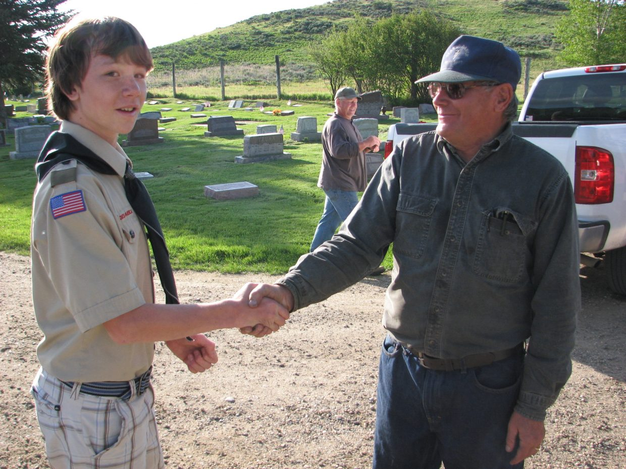 Boy Scout Spencer Vaughan shaking hands with a veteran. Submitted by Wendy Vaughan