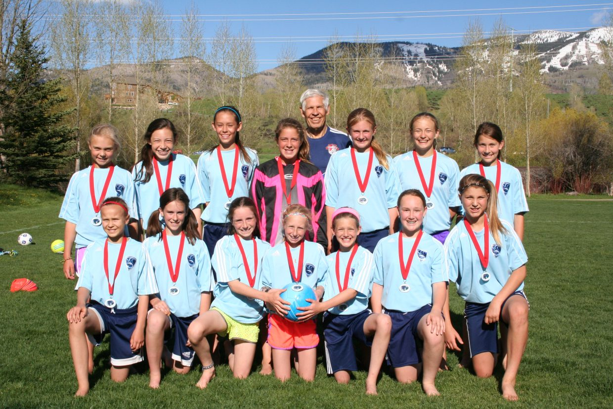 The Steamboat Springs U12 girls soccer team was second in the Grand Mesa Invitational soccer tournament in Grand Junction last weekend. The team went 2-1-1, falling in the championship game to a team from Park City, Utah. Pictured are, back row from left, Riley Smith, Rachelle Koly, Maddie Heydon, Caroline Lupori, coach Jim Dudley, Grace Creamer, Lily Starkey and Megan Sayler. Front row from left, Annika Malacinski, Caitlin Smith, Waverly Gebhardt, Margaret Dickson, Isabelle Boniface, Gretchen Jacobs and Izzy Rillos. Not pictured are Corey Petix and Lucy Wilson.