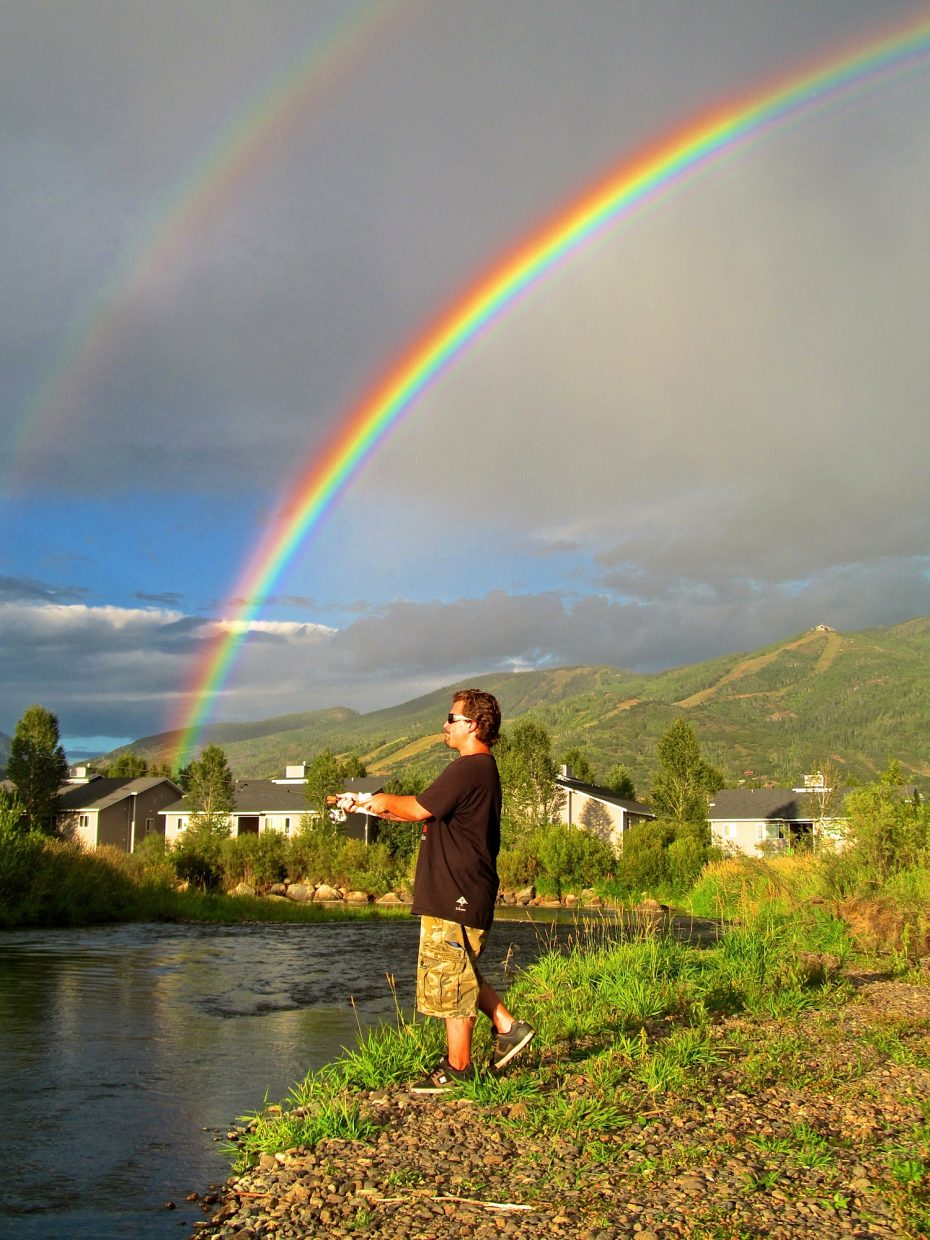 Matt fishing under the rainbow on Monday. Submitted by: Ryan Lohan