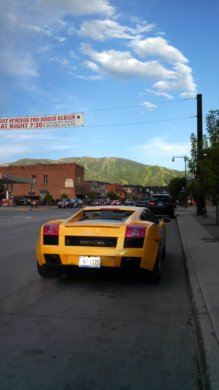 Someone is having fun driving through the mountains in this Lamborghini! It is not mine, but it looks awesome with the mountain in the background. Submitted by: Jon Wink