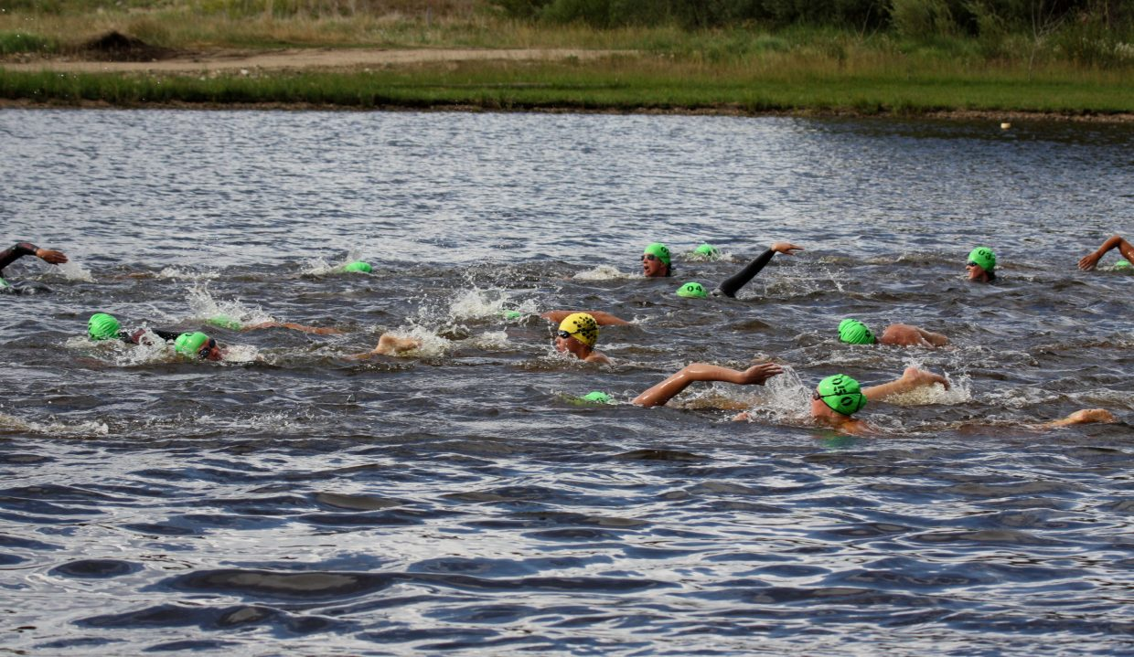 Participants swim in the fourth of the five series Bald Eagle Lake Open Water Swim Series on Monday. Photo by: Tom Scrimgeour