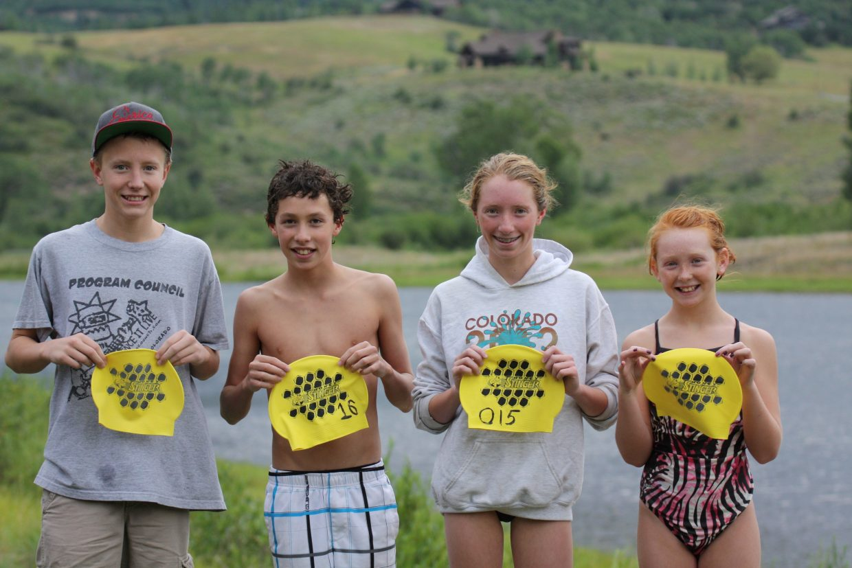 Frank Ruppel, left, and Samantha Terranova, second from right, were the male and female winners of the mile swim for the fourth Bald Eagle Lake Open Water Swim Series on Monday. Tyler Terranova, second from left, was the male winner of the half-mile race. There were no age classes. Photo by Tom Scrimgeour