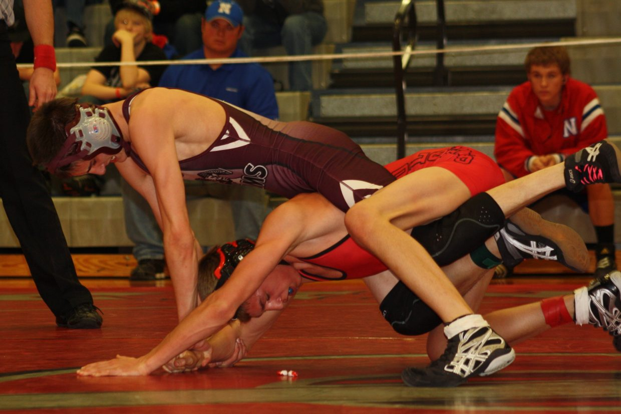 Colton Martindale, of the Soroco Rams, goes up against Deano Valdez, of Dolores. Submitted by: Susie Koler