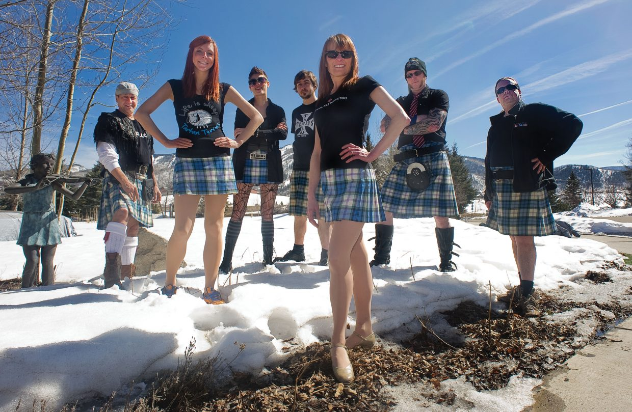 Members of the Tartan Terrors, a Celtic music, dance and comedy troupe, pose outside the Strings Music Pavilion on Tuesday. The band plays a special pre-St. Patrick's Day show Thursday night at the Pavilion.