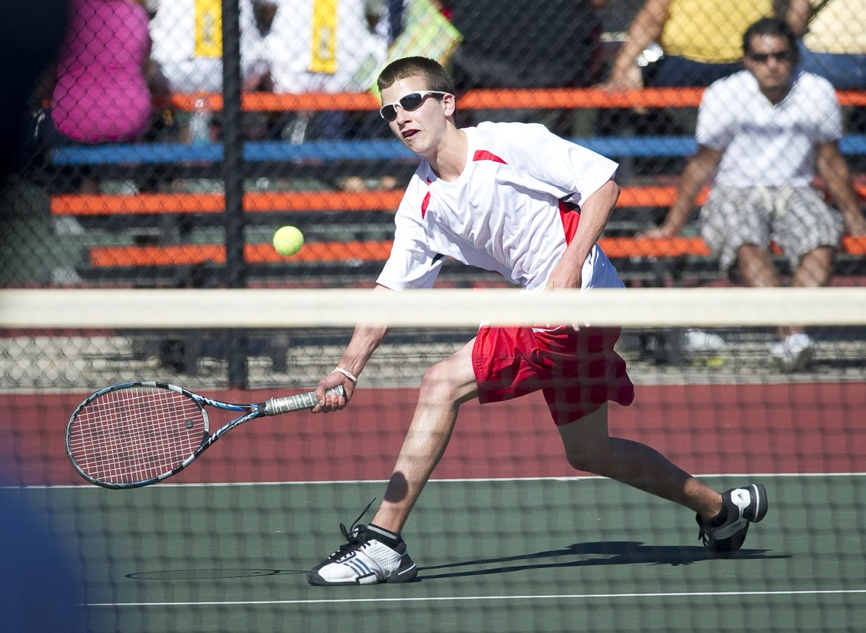 Steamboat Springs' Jack Burger fires a shot against Broomfield's Matt Depinto in the quarterfinals of the state high school tennis championships in Pueblo on Thursday afternoon. Jack Burger and his brother Keegan advanced to Friday's semifinals.
