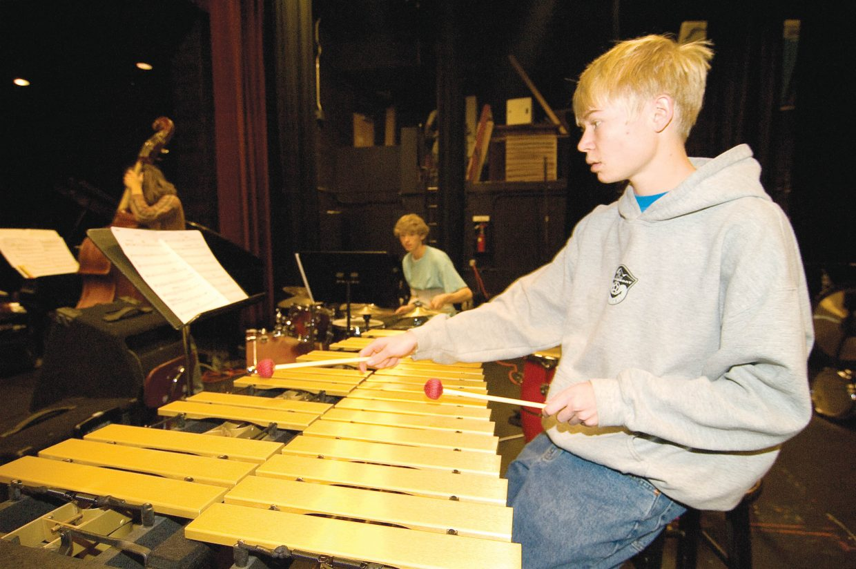 Percussionist Kyle Kounorsky practices with the Jazz Band. The band will be performing traditional jazz tunes and some modern music and holiday selections during its Wednesday night concert.