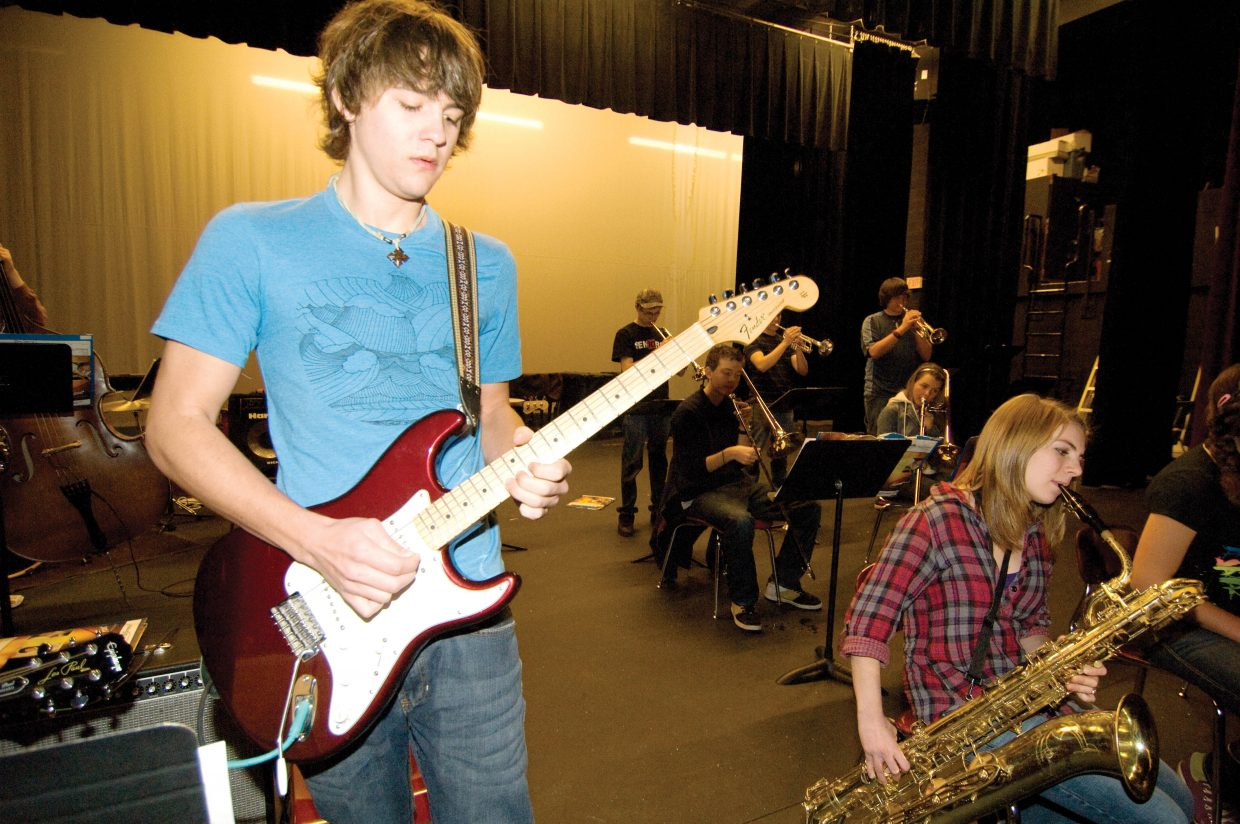 Guitarist Noah Pfaff lays down a tune during a solo while practicing with the Steamboat Springs High School Jazz Band.