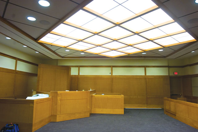 A new courtroom nears completion in the new Justice Center building during a tour of the facility on Friday morning.