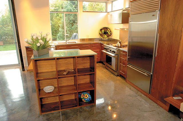In keeping with the Reagins'  minimalist approach to design, the couple passed on the opportunity to add storage in their kitchen with overhead cabinets. The gleaming kitchen counters are typically empty of small appliances  toasters, blenders and utensil holders.
