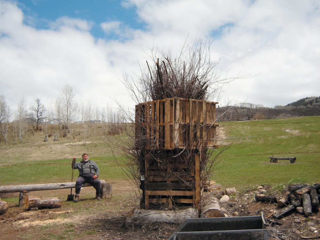 Wayne Kakela hosted a bonfire every fall for years on his Strawberry Park land. Here, he sits next to a bonfire he constructed with members of the Colorado Art Ranch, a residency program that brought painters, sculptors, filmmakers and others to live and work in Steamboat Springs in summer 2008.