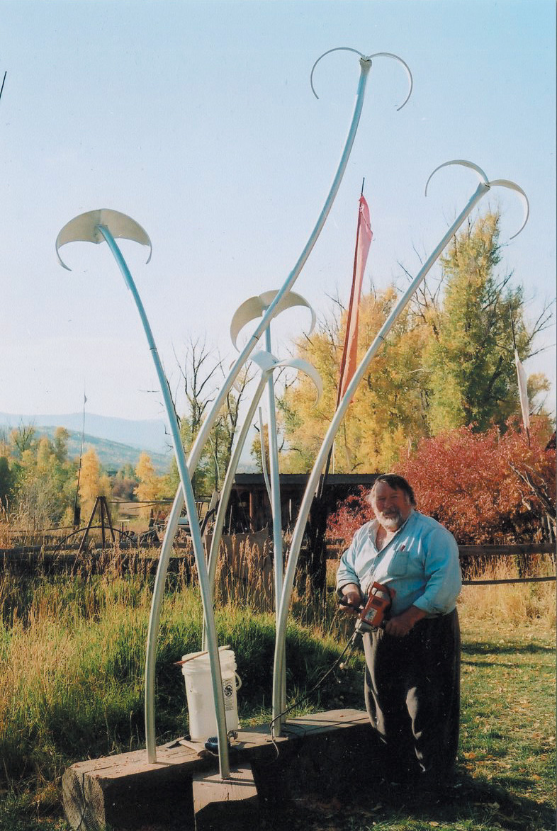 """Wayne Kakela with """"White Flight,"""" a metal sculpture he built for the Creative Community Project in summer 2008. The project, sponsored by Home ReSource, involved participants making works of art out of materials found at the salvage center. Kakela was one of the first artists to express interest in building a Creative Community piece."""