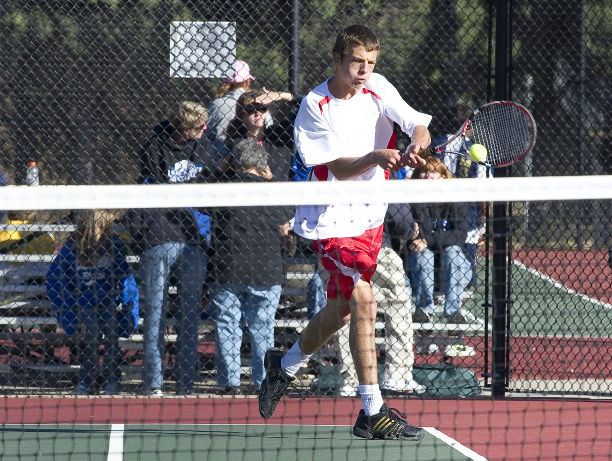 Steamboat's No. 1 singles player Keegan Burger returns a shot during the opening day of the state high school tennis tournament in Pueblo. Burger defeated John Lambert, of Bishop Machebeuf, 6-0, 6-0, in first round.