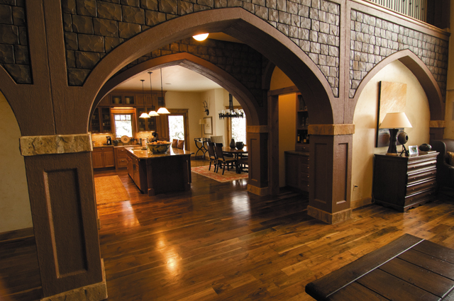 Tinted concrete archways greet visitors the moment they enter this 8,536-square-foot Tatanka Ridge home built by Maynard Kline.