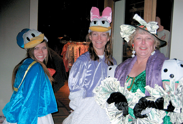 Laurie Good, who is the vice president of accounting at Steamboat Ski and Resort Corp., dresses as Lady Luck, right.