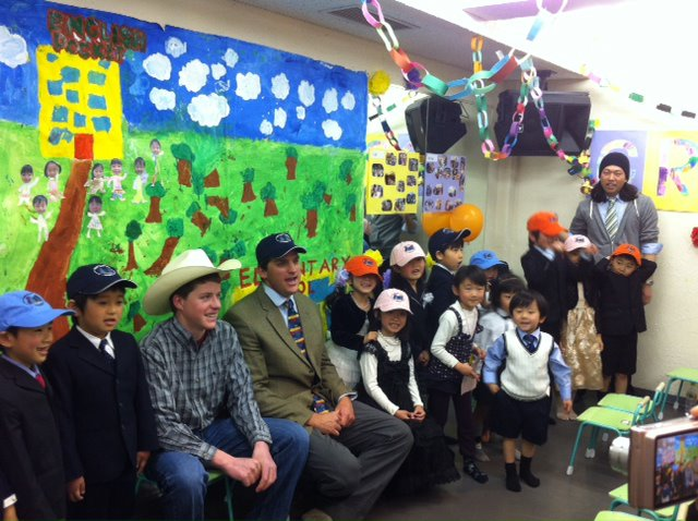 Liam Delaney, from Hayden, and his Yampa Valley Feeds hats were a hit with his Uncle Aran's graduating kindergarten class in Tokyo, Japan. Submitted by: Tammie Delaney