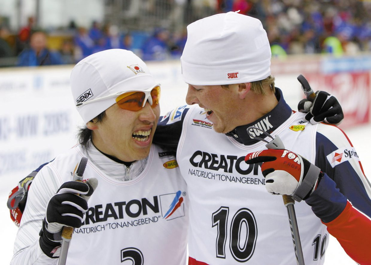Second-placed Daito Takahashi, of Japan, and third-placed Todd Lodwick, of the United States, smile after the men's 7.5-kilometer World Cup Nordic Combined event on Feb. 15, 2004, in Oberstdorf, Germany.