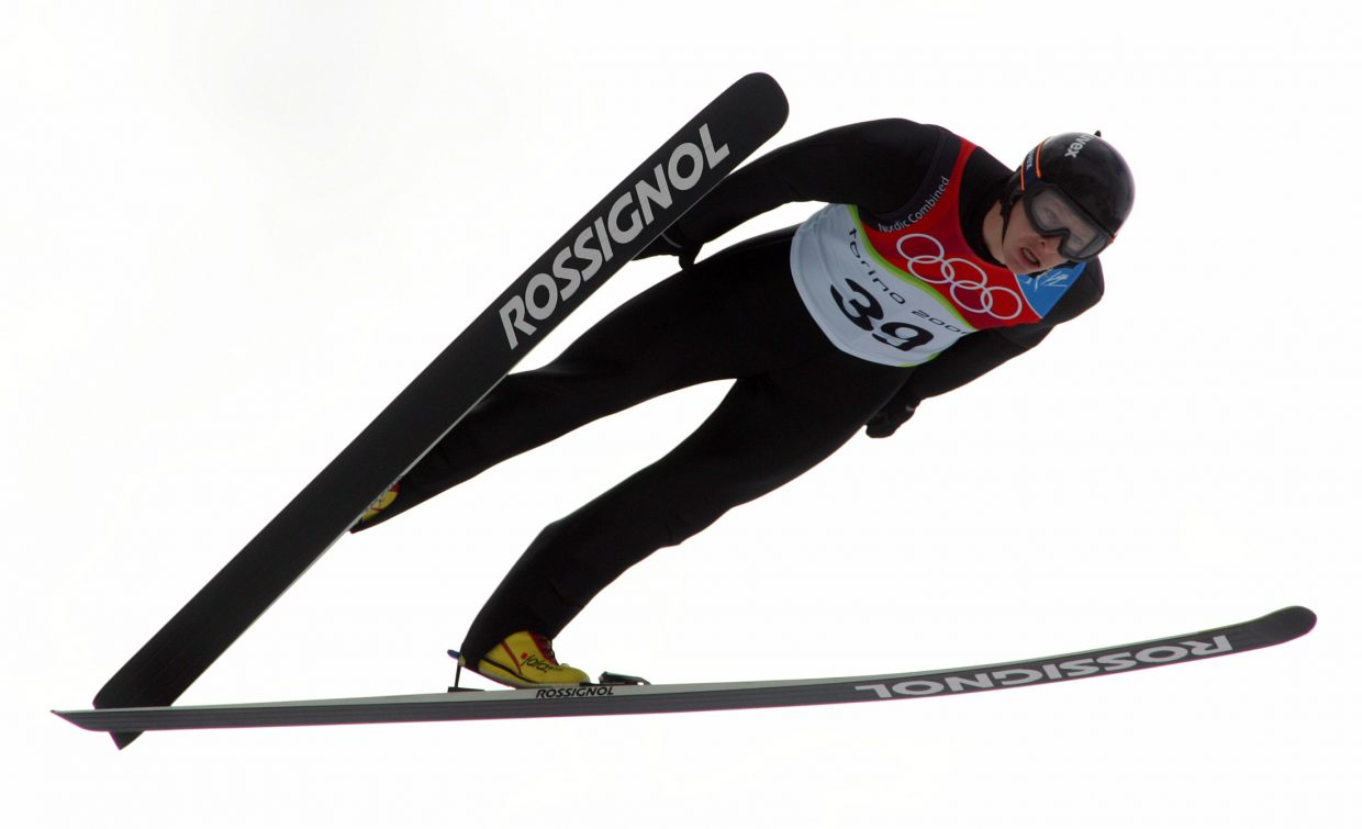 Todd Lodwick, of the U.S., soars through the air during his jump for the Nordic combined sprint competition at the Torino 2006 Winter Olympic Games in Pragelato, Italy, on Feb. 21, 2006.