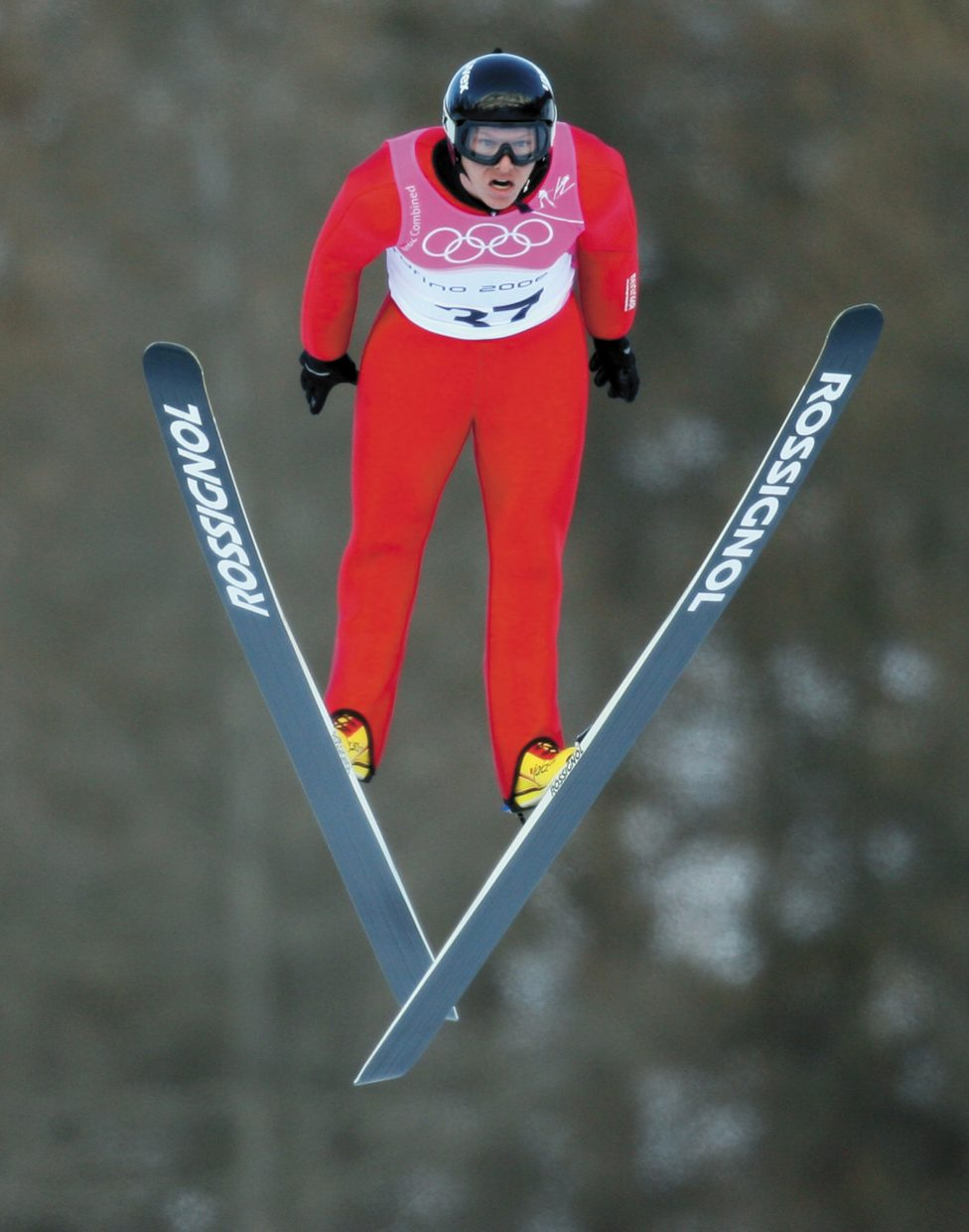Nordic combined athlete Todd Lodwick, of the U.S., soars through the air during the first free practice session for the Nordic combined at the Torino 2006 Winter Olympic Games in Pragelato, Italy,on Feb. 8, 2006.