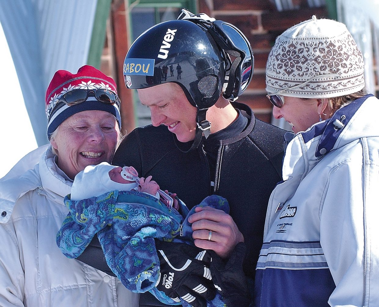 Surrounded by his mom, Jeanne, and wife, Sunny, Todd Lodwick takes a few minutes after the U.S. National normal hill championships at Howeslen Hill to hold newborn daughter, Charley. After years of chasing his World Cup ambitions, it appears that Lodwick plans to start the next chapter of his life in Steamboat.