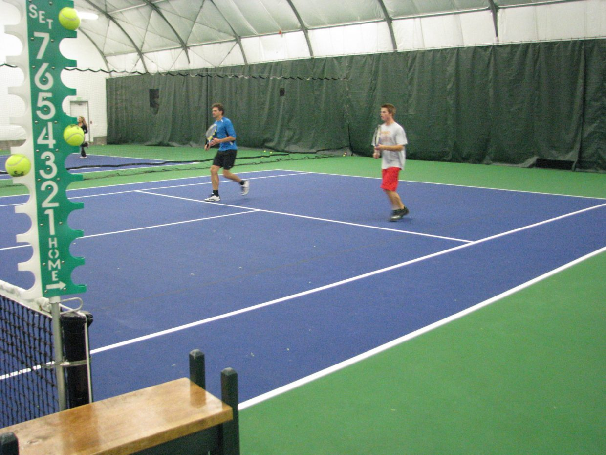 Loui Nijsten and Luke Farney play during Saturday's Steamboat City Singles and Doubles Championships at Tennis Center at Steamboat Springs.