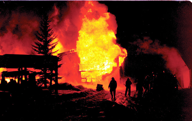 A fire destroys the Main Lodge at Lowell Whiteman School on Feb. 9, 1977. After returning from their spring foreign trip, Lowell Whiteman students finished classes at Perry-Mansfield, and construction began on the Charley Williams Lodge that summer.