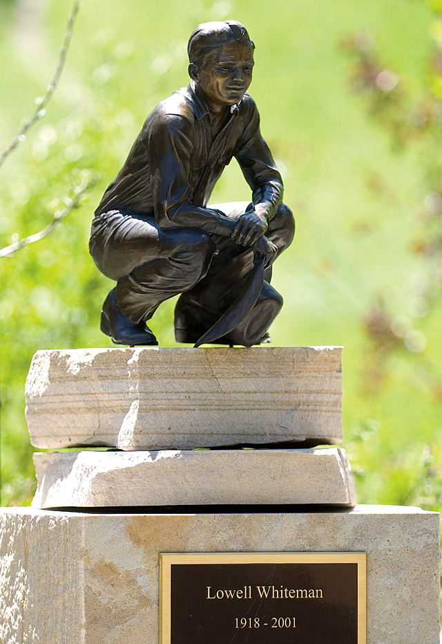 A small statue of Lowell Whiteman stands near a pond on the Lowell Whiteman School's campus in Steamboat Springs on Friday.