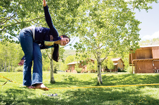 Molly Newman struggles to stay on a slack line at the Lowell Whiteman School's campus on Friday. The school will be celebrating its 50th anniversary this week.