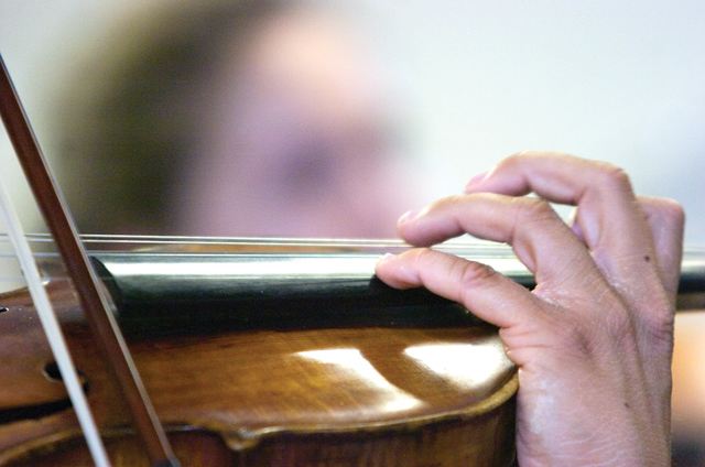 A violin and its owner rest weave a tune during a master class for the Rocky Mountain Summer Conservancy at the Lowell Whiteman School on Tuesday afternoon.