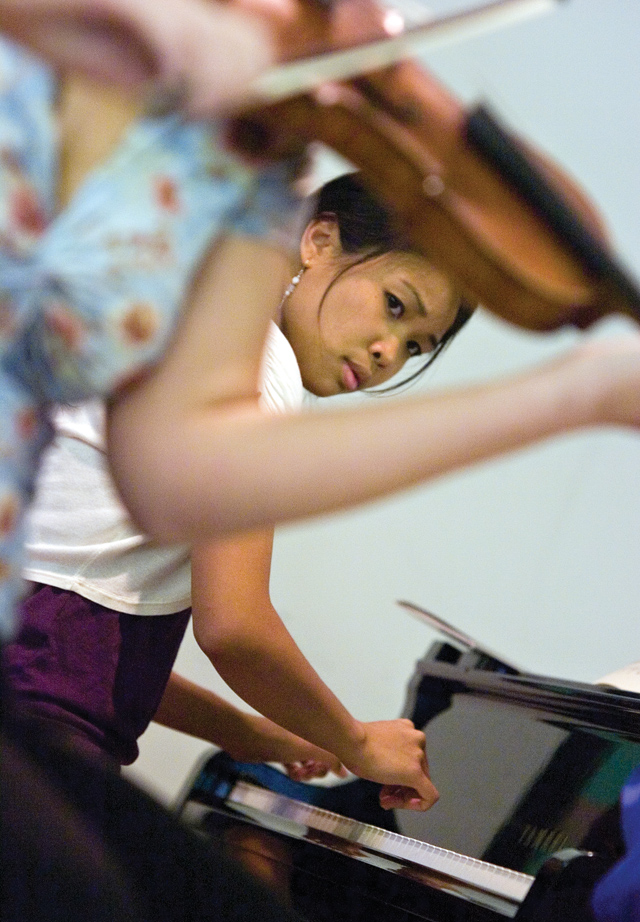 Pianist Christina Lalog pauses to check out the string players during a master class for the Rocky Mountain Summer Conservancy at the Lowell Whiteman School on Tuesday afternoon.