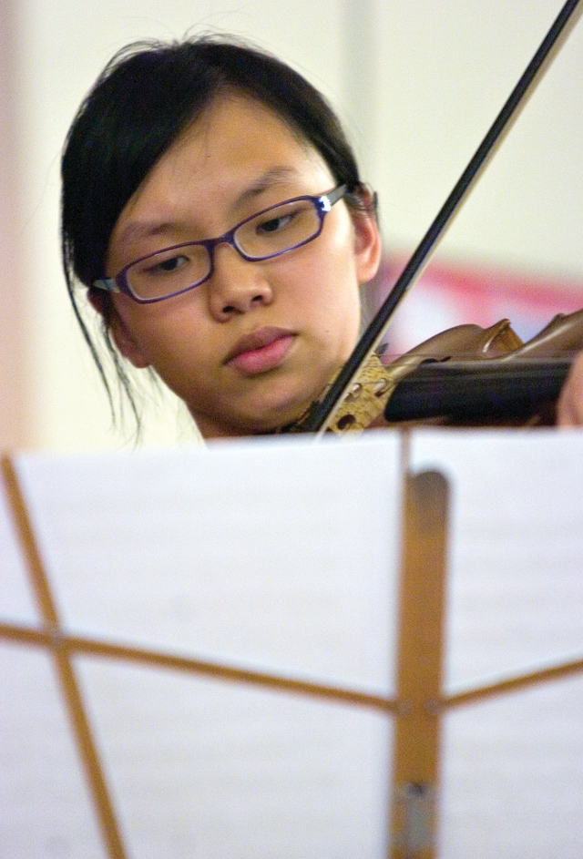 Musician Jarita Ng practices her viola during a master class for the Rocky Mountain Summer Conservancy at the Lowell Whiteman School on Tuesday afternoon.