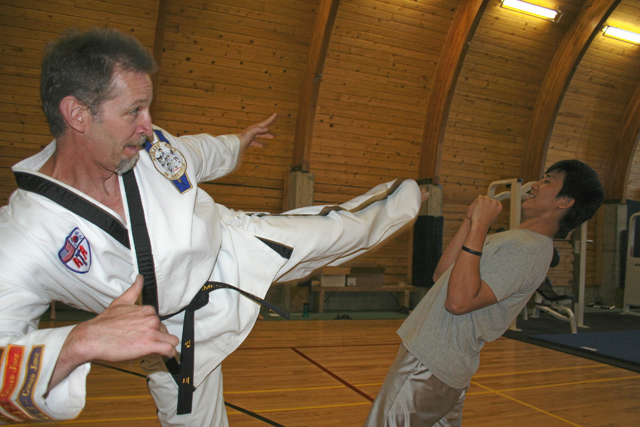 A tae kwan do instructor works with an RMSC student. All students are encouraged to take classes outside of their core music lessons, including photography and eurythmics.