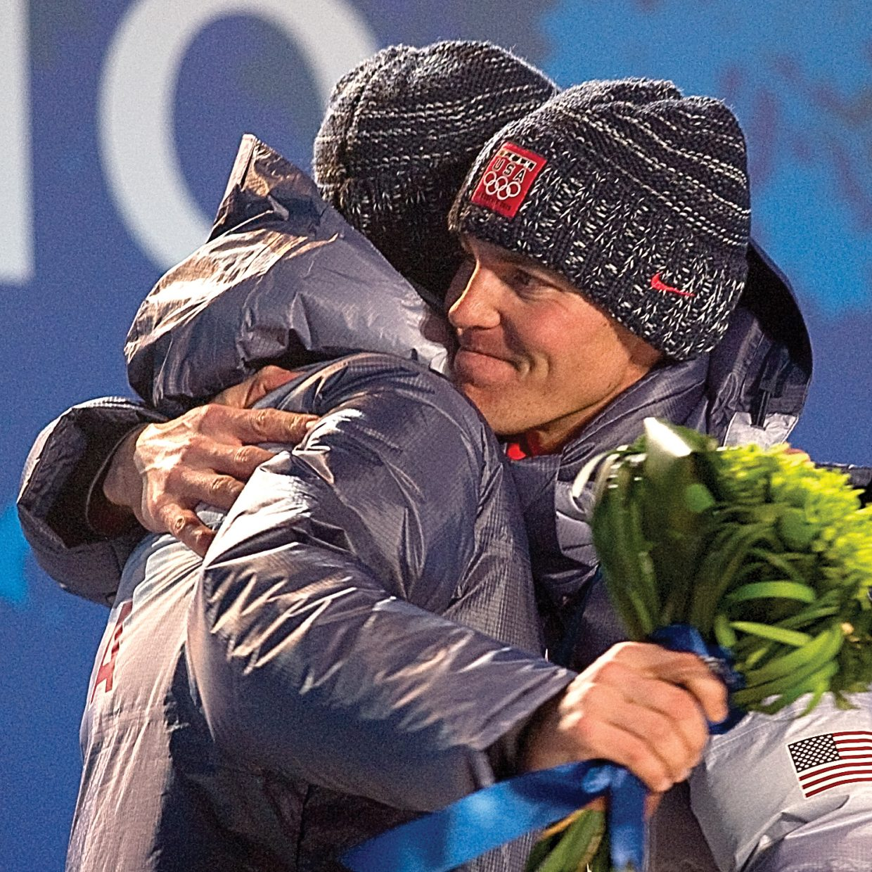 Olympic gold medalist Billy Demong, right, hugs teammate Johnny Spillane at Whistler Olympic Celebration Plaza on Thursday night. The pair dominated today's large hill individual Gundersen event. Steamboat's Spillane, who was also second in the normal Hill Individual Gundersen event Feb. 14, earned the silver to cap off the U.S. Ski Team's best showing at an Olympics.
