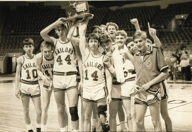 The 1986 Steamboat Springs High School basketball team shows off its third place trophy from the state tournament.