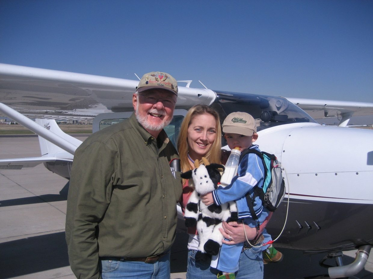Mike Forney, left, is seen with Mary and Riggen Tangbakken. Forney was named the Wing Leader of the Colorado Wing of Angel Flight West, a nonprofit organization that arranges free, non-emergency air travel for medical and other essential servces.