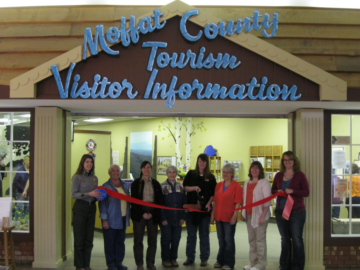 Melody Villard, Moffat County Tourism Director, cuts the ribbon during the Steamboat Springs Chamber Resort Association ceremony for Moffat County Tourism's new location and grand opening on March 10.